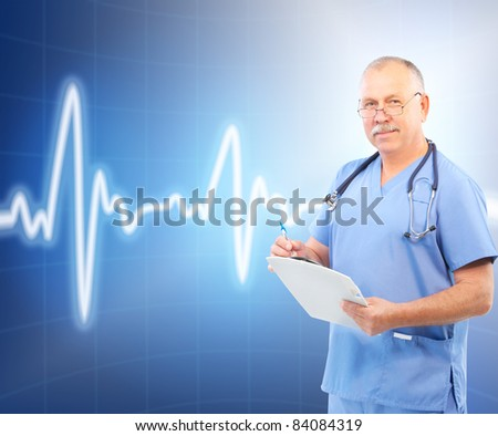 Mature smiling medical doctor. Over blue background. - stock photo