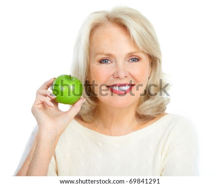 Mature smiling woman with a green apple