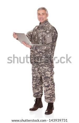 Mature Soldier Holding Laptop Isolated On White Background - stock photo