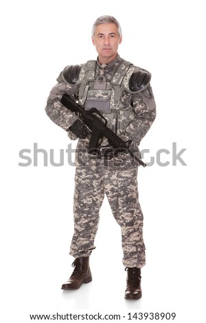 Mature Soldier Holding Rifle Isolated On White Background