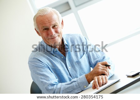 Mature student in class - stock photo