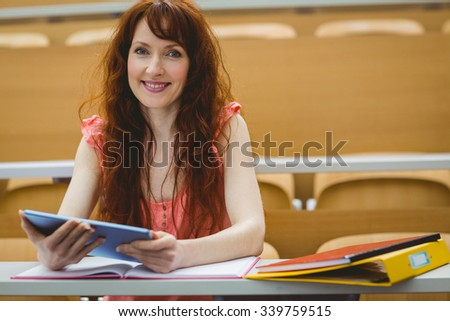Mature student in lecture hall at the university