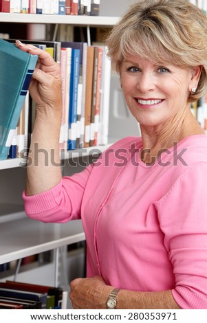 Mature student in library - stock photo