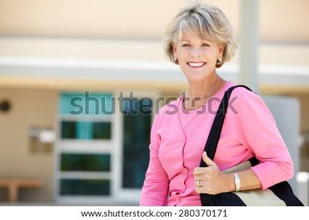 Mature student outdoors - stock photo