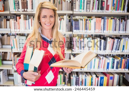 Mature student studying in the library at the university - stock photo