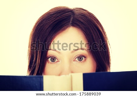 Mature student woman with book - stock photo
