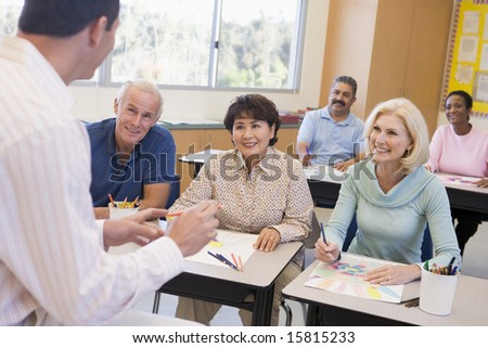 Mature students learning art skills - stock photo