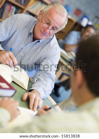 Mature students studying in library - stock photo