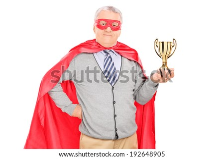 Mature superhero holding a trophy isolated on white background - stock photo