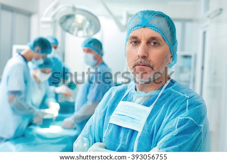 Mature surgical doctor is expressing sincerity