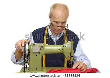 Mature tailor with a sewing  machine isolated in white - stock photo