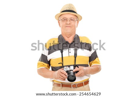 Mature tourist holding a camera and posing isolated on white background - stock photo