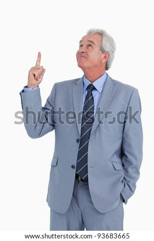 Mature tradesman pointing and looking up against a white background