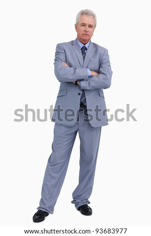 Mature tradesman with his arms folded against a white background