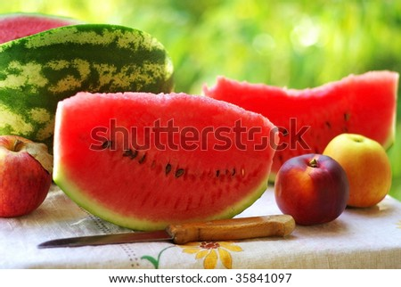 Mature Watermelon, fruits and knife. - stock photo