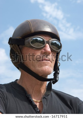 Mature weird man wearing an obsolete helmet
