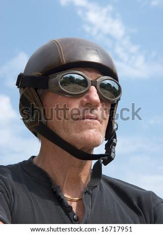 Mature weird man wearing an obsolete helmet - stock photo