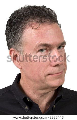 Mature white male with a very cynical expression on his face. - stock photo