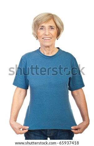 Mature woma showing her blue blnk t-shirt and smiling isolated on white background