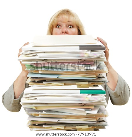 Mature woman almost buried by a mountain of paperwork - stock photo