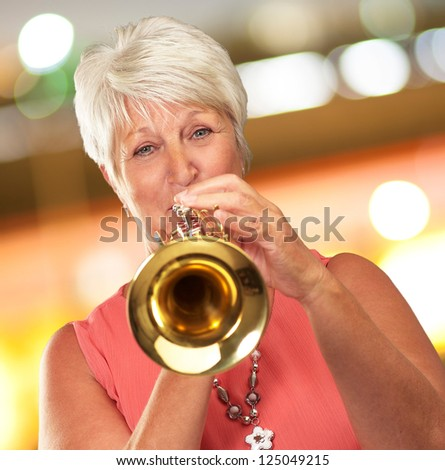 Mature Woman Blowing Her Trumpet, Indoor - stock photo
