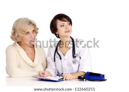Mature woman came to the reception to the young doctor - stock photo