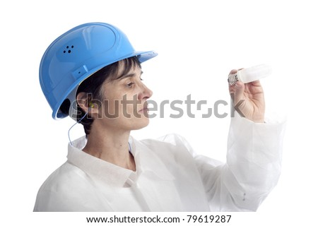 mature woman doing a quality control of a lamp. isolated on white background - stock photo