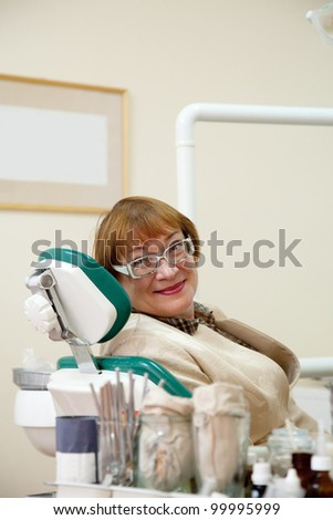 Mature woman during visit at the dentist - stock photo