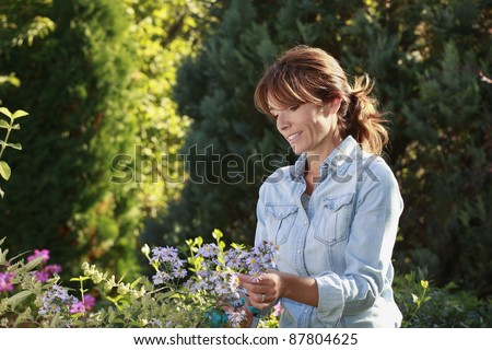 Mature woman gardening in her backyard