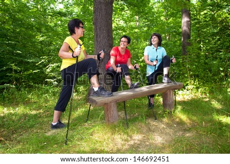 mature woman Group while athletic exercises to warm up for training - stock photo