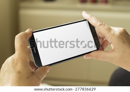 mature woman hands with a 3d generated smartphone with blank screen - stock photo