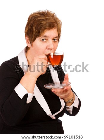 Mature woman having cup of tea isolated