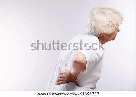Mature woman holding his sore back - stock photo