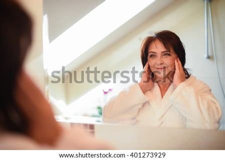 Mature woman in bathroom