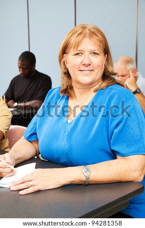 Mature woman in diverse adult education class - stock photo