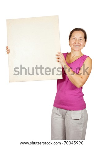 mature woman  in sport holds blank placard, over white background - stock photo