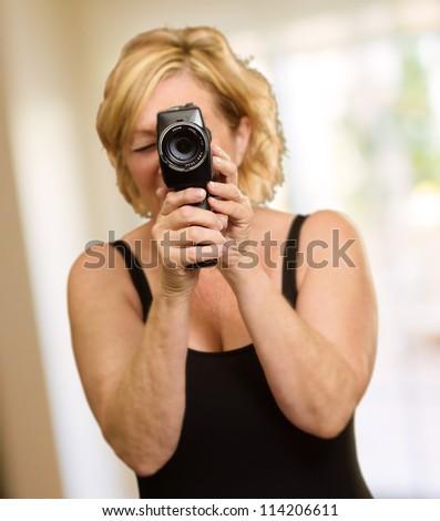 Mature Woman Looking Through Camera, Indoors - stock photo