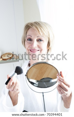 Mature Woman Making Up - stock photo