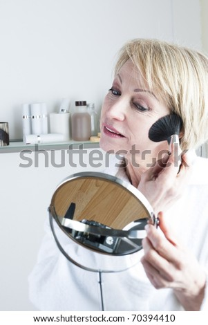 Mature Woman Making Up