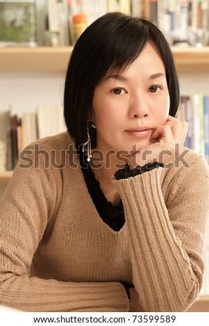 Mature woman of Asian at home, closeup portrait inside of house.