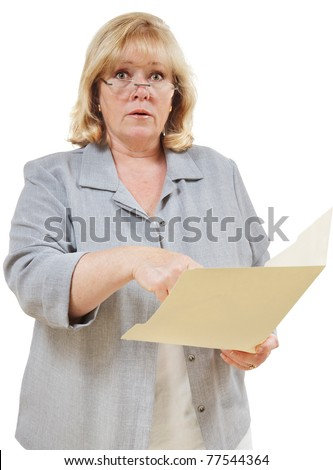 Mature woman points to contents of a folder - stock photo