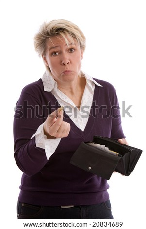 Mature woman pulling a face and holding up a eurocoin - stock photo