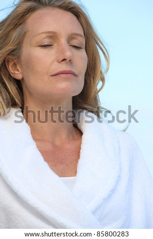 Mature woman relaxing with eyes closed - stock photo
