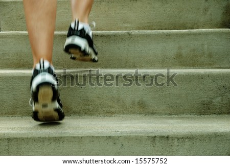Mature woman runner in the city, close up. - stock photo