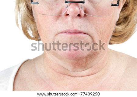Mature woman's lower face and neck showing the aging process - stock photo