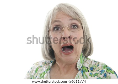 Mature woman scared and shocked isolated on white. - stock photo