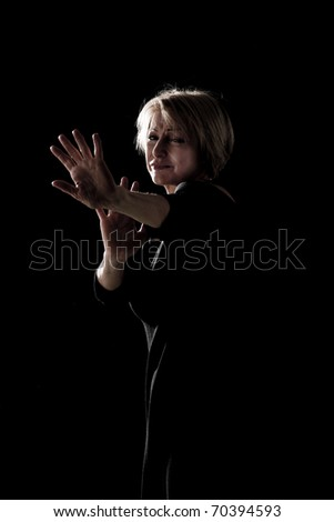 Mature woman scared of something/actress on stage