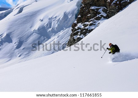 Mature woman skiing powder snow on a glacier in the Val de Ayas, Italian alps. - stock photo