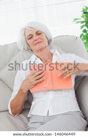 Mature woman sleeping whereas she was reading a book