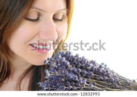Mature woman smelling bunch of dried lavender - stock photo